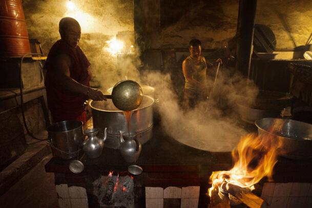 monks cooking in tibetan monastery