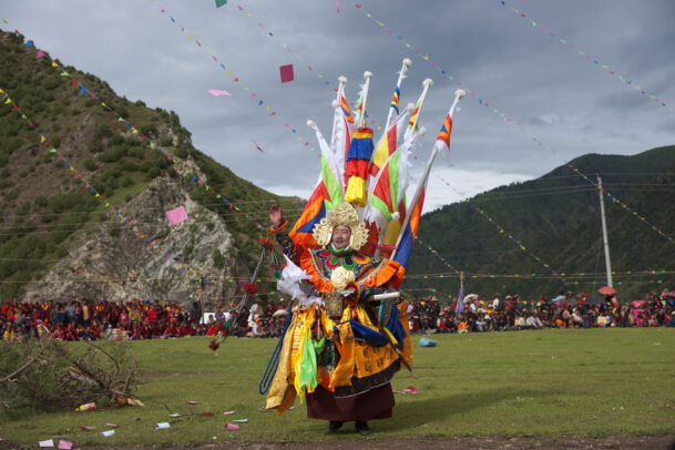 an actor portrays the legendary Tibetan warrior King Gesar at a festival at Shechen monastery