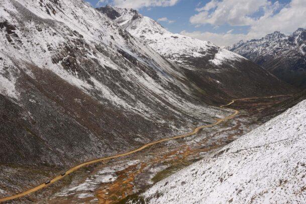 tibetan narrow street across the snow mountains