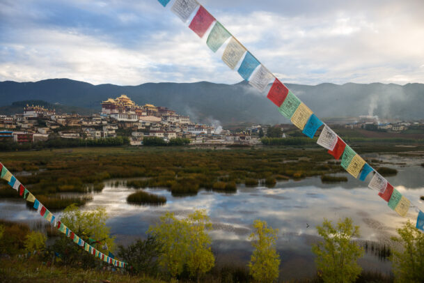 Tibetan prayer flags on the lake near the Songzanlin Monastery