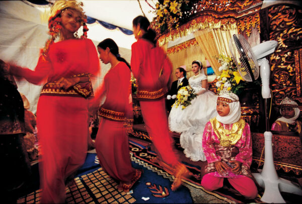 woman with red dresses dancing for wedding celebrations