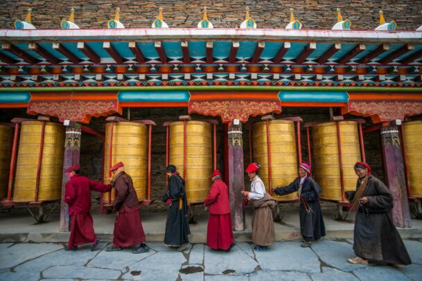 people praying at a buddhist temple in shangri la